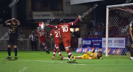 Stock Picture of Salford goalkeeper Tom King is beaten by Crawley's second goal scored by Jake Hessenthaler during the Sky Bet League Two match between Crawley Town and Salford City at the People's Pension Stadium  , Crawley ,  UK - 17th August 2021