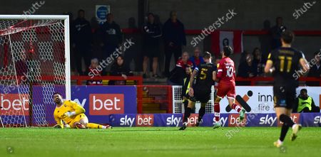 Ashley Nadesan of Crawley (no 10) shoots past Tom King of Salford to score their first goal and equalise in the first half during the Sky Bet League Two match between Crawley Town and Salford City at the People's Pension Stadium  , Crawley ,  UK - 17th August 2021