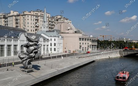 A ship sails near the sculpture 'Big clay No. 4' by Swiss artist Urs Fischer in Moscow, Russia, 16 August 2021. The 12-meter composition 'Big clay No. 4' cast from aluminium is a copy of a lump of clay that Urs Fischer was kneading in his hands. The sculpture will be on display for several months. Some residents of Moscow criticized the art object for being ugly.