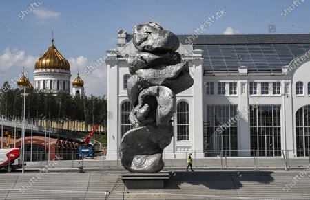 A view of the sculpture 'Big clay No. 4' by Swiss artist Urs Fischer in Moscow, Russia, 16 August 2021. The 12-meter composition 'Big clay No. 4' cast from aluminium is a copy of a lump of clay that Urs Fischer was kneading in his hands. The sculpture will be on display for several months. Some residents of Moscow criticized the art object for being ugly.