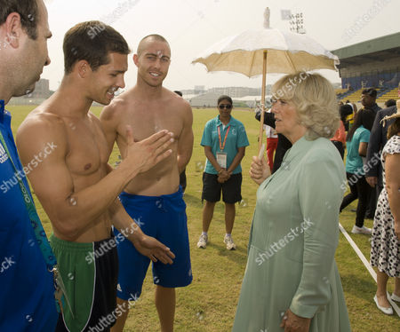 Stock Image of Camilla Duchess of Cornwall Meets Decathletes Tom Reynolds 25 From Bangor Northern Ireland and Roger Skedd 28 From Scotland