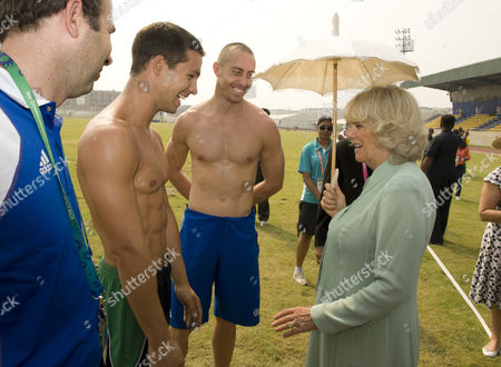 Stock Photo of Camilla Duchess of Cornwall Meets Decathletes Tom Reynolds 25 From Bangor Northern Ireland and Roger Skedd 28 From Scotland