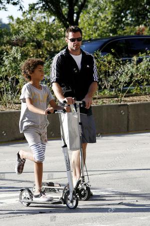 Hugh Jackman (R) and Oscar Maximillian