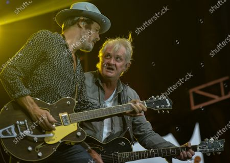 Canadian musician Tom Cochrane (center) and guitarist Bill Bell (left) perform on stage during Edmonton Rock Fest as part of the Together Again series at the historic Racetrack Infield on the Edmonton Exhibition Lands (formerly Northlands Park) in Edmonton.On Saturday, 14 August 2021, in Edmonton, Alberta, Canada.
