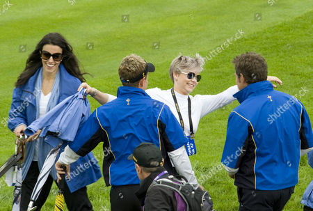 Holly Sweeney, girlfriend of Rory McIlroy, congratulates early winners Luke Donald and Lee Westwood