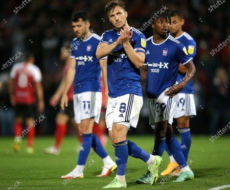 Lee Evans of Ipswich Town applauds the fans