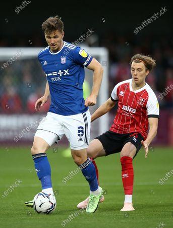 Lee Evans of Ipswich Town and Callum Wright of Cheltenham Town