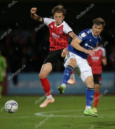 Callum Wright of Cheltenham Town battles with Lee Evans of Ipswich Town