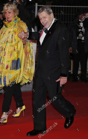 """Stock Photo of Actor Jerry Lewis (R) and Yanou Collart arrive on the red carpet after a screening of the film """"Bright Star"""" at the 62nd annual Cannes Film Festival in Cannes, France on May 15, 2009."""