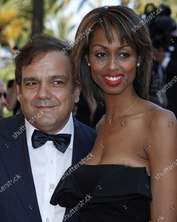"""Actor Didier Bourdon and guest arrive on the red carpet before a screening of the film """"Un prophete"""" at the 62nd annual Cannes Film Festival in Cannes, France on May 16, 2009."""
