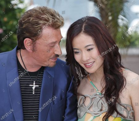 """Rocker/actor Johnny Hallyday and actress Michelle Ye arrive at a photocall for the film """"Vengeance"""" at the 62nd annual Cannes Film Festival in Cannes, France on May 17, 2009."""