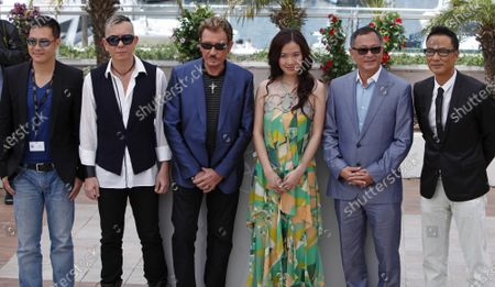"""(From L to R) Actors Siu-Fai Cheung and Anthony Wong, rocker/actor Johnny Hallyday, actress Michelle Ye, director Johnnie To and actor Simon Yam arrive at a photocall for the film """"Vengeance"""" at the 62nd annual Cannes Film Festival in Cannes, France on May 17, 2009."""