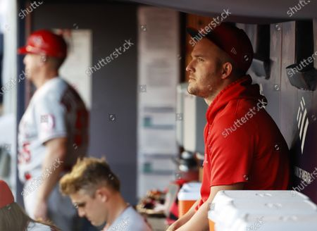 Los Angeles Angels Centerfielder Mike Trout (R) sits in his teams dugout before the start of the first inning of the Major League Baseball (MLB) game between the Los Angeles Angels and New York Yankees in the Bronx, New York, USA, 16 August 2021.