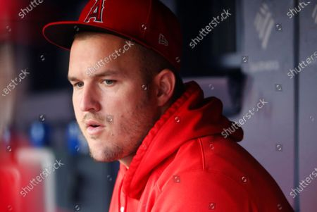Los Angeles Angels' Mike Trout looks on in the dugout before baseball game against the New York Yankees, in New York