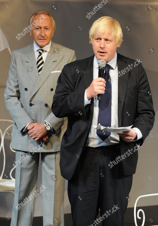 Editorial picture of London Fashion Week Opened By The Mayor Of London Boris Johnson Wearing A Suit From China A Shirt From M&s And Shoes From Church's Pictured With Him Is Harold Tilman The Chairman Of The British Fashion Council Wearing A Suit By Jaeger . Picture ...