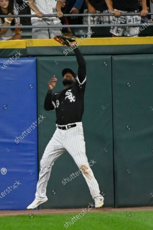 Chicago White Sox center fielder Luis Robert catches a ball hit by Oakland Athletics' Seth Brown during the sixth inning of a baseball game, in Chicago