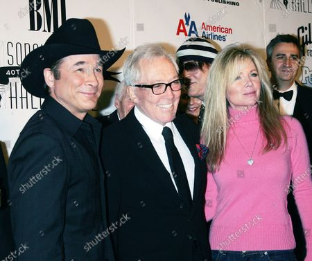 Andy Williams (C) and Clint Black and wife Lisa Hartman Black arrive for the 2009 Songwriters Hall of Fame 40th Anniversary Induction Ceremony and Gala at the Marriott Marquis Hotel in New York on June 18, 2009.