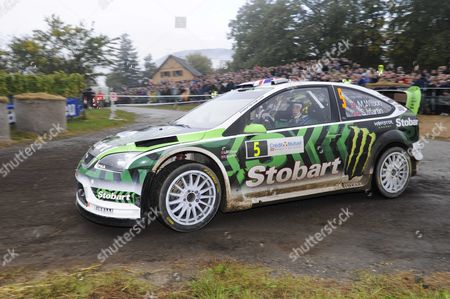 Stock Photo of Ford team driver Matthew Willson and Martin Scott of Britain (GB) in his Ford Focus RS WRC