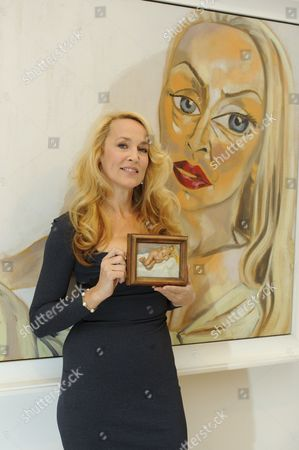 Jerry Hall with 'Eight Months Gone' by Lucian Freud estimated sale value GBP 300,000-4,000,000. Behind is 'Jerry Hall' by Francesco Clemente estimated sale value GBP 1000,000-150,000
