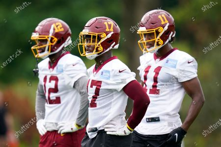 Washington Football Team wide receiver Terry McLaurin, center, prepares to run a drill alongside teammates Tony Brown, left, and Antonio Gandy-Golden during an NFL football practice, in Ashburn, Va