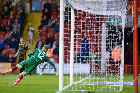 Walsall Carl Rushworth (12) makes a save during the EFL Sky Bet League 2 match between Walsall and Scunthorpe United at the Banks's Stadium, Walsall