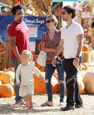 Stock Photo of Jennifer Meyer (C), Tobey Maguire (R) and daughter Ruby Sweetheart