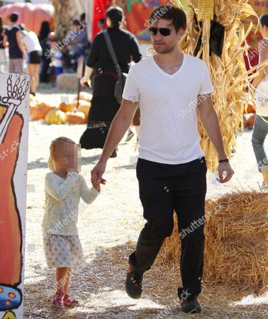 Stock Picture of Tobey Maguire and daughter Ruby Sweetheart