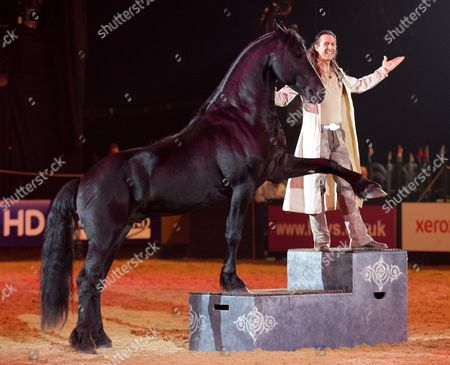 Stock Picture of Frederic Pignon with a Lusitano horse