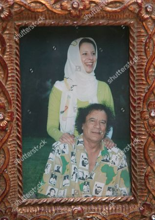 Ayesha al-Gaddafi with her father in a framed picture