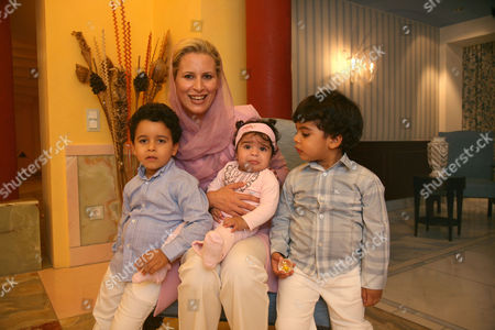 Ayesha al-Gaddafi with sons Muammar and Abdisalam and daughter Jenna