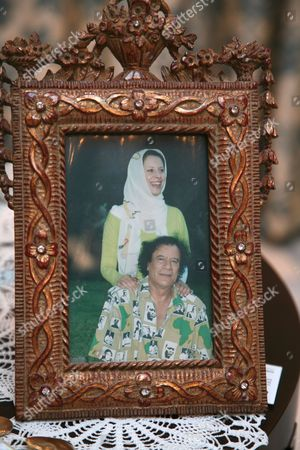 Stock Image of Ayesha al-Gaddafi with her father in a framed picture