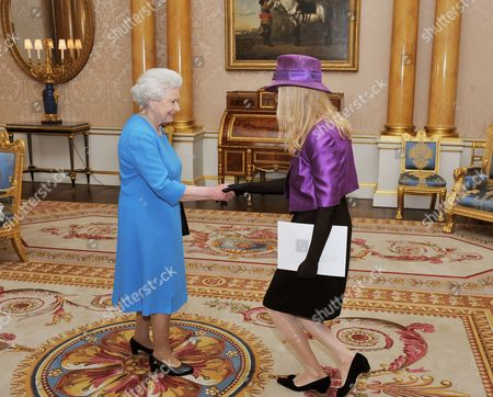 Queen Elizabeth II shaking hands with Her Excellency the Ambassador of Sweden Ms Nicola Clase, before she presented her credentials during a private audience