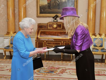 Queen Elizabeth II shakes hands with Her Excellency the Ambassador of Sweden Ms Nicola Clase, before she presented her credentials during a private audience