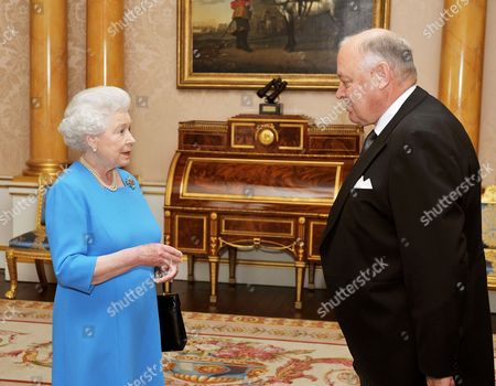 Stock Picture of Queen Elizabeth II shakes hands with His Excellency the Ambassador of Finland Mr Pekka Huhtaniemi, before he presented his credentials