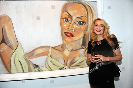 Jerry Hall with an artwork by Francesco Clemente