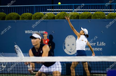 Shuai Zhang of China & Sam Stosur of Australia in action during the doubles semi-final at the 2021 Western & Southern Open WTA 1000 tennis tournament