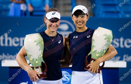 Sam Stosur of Australia & Shuai Zhang of China with their champions trophies after winning the doubles final at the 2021 Western & Southern Open WTA 1000 tennis tournament