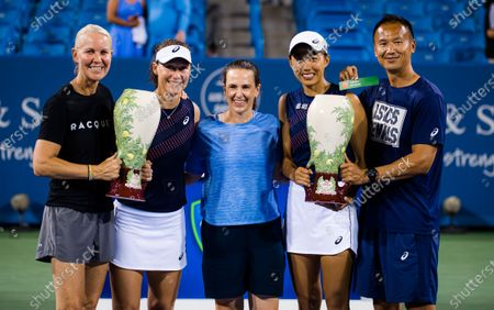 Sam Stosur of Australia & Shuai Zhang of China pose with their team and their champions trophies after winning the doubles final at the 2021 Western & Southern Open WTA 1000 tennis tournament