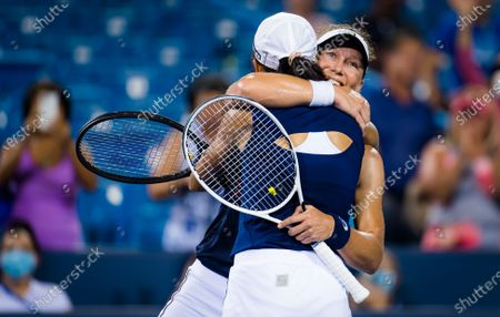Stock Picture of Sam Stosur of Australia & Shuai Zhang of China celebrate winning the doubles final at the 2021 Western & Southern Open WTA 1000 tennis tournament