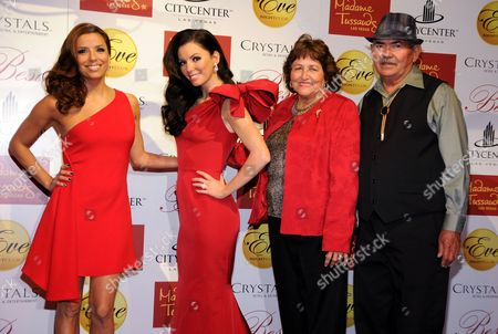 Eva Longoria Parker and her waxwork model with her parents Ella Eva Mireles and Enrique Longoria