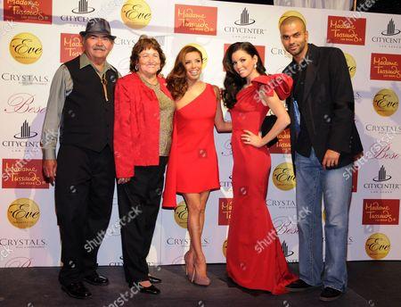 Enrique and Ella Eva Mireles, Eva Longoria Parker, waxwork model and Tony Parker