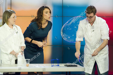 Stock Image of Scientists James Frecknall and Gemma Price assisted Christine Bleakley
