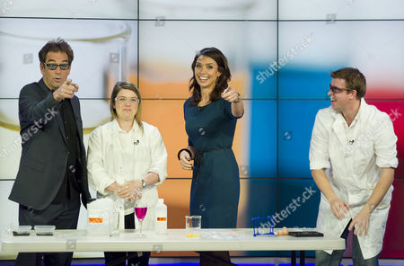 Stock Picture of Scientists James Frecknall and Gemma Price assisted by Huey Lewis and Christine Bleakley