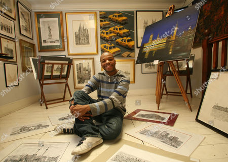 Stephen Wiltshire with some of his work