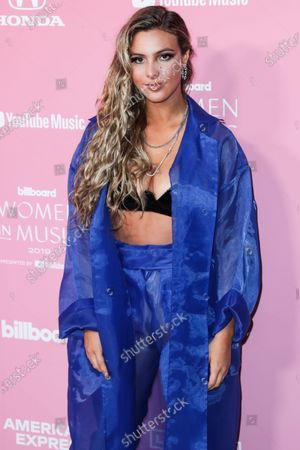 Internet personality LeLe Pons arrives at the 2019 Billboard Women In Music Presented By YouTube Music held at the Hollywood Palladium on December 12, 2019 in Hollywood, Los Angeles, California, United States.
