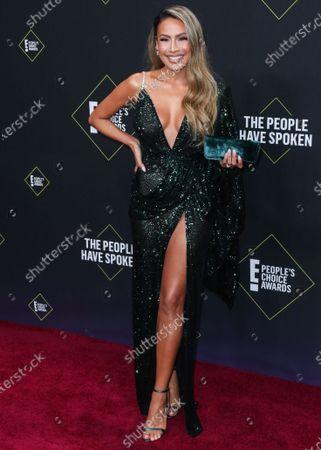 Desi Perkins arrives at the 2019 E! People's Choice Awards held at Barker Hangar on November 10, 2019 in Santa Monica, Los Angeles, California, United States.