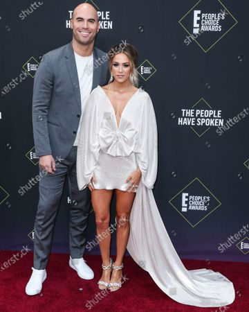 Mike Caussin and wife/singer Jana Kramer arrive at the 2019 E! People's Choice Awards held at Barker Hangar on November 10, 2019 in Santa Monica, Los Angeles, California, United States.