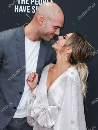 Stock Image of Mike Caussin and wife/singer Jana Kramer arrive at the 2019 E! People's Choice Awards held at Barker Hangar on November 10, 2019 in Santa Monica, Los Angeles, California, United States.