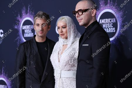 Stock Photo of Ian Axel, Christina Aguilera and Chad King arrive at the 2019 American Music Awards held at Microsoft Theatre L.A. Live on November 24, 2019 in Los Angeles, California, United States.