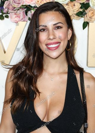 Model Devin Brugman arrives at the 3rd Annual #REVOLVEawards 2019 held at Goya Studios on November 15, 2019 in Hollywood, Los Angeles, California, United States.